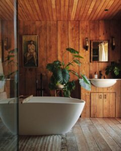 white bath in bathroom with wooden panelling
