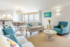luxury sitting room with white couches and blue furnishings