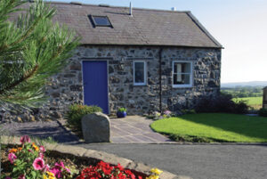 stone cottage with blue door in Wales