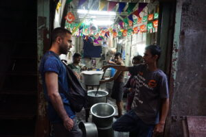Two men chatting in a market in Dharavi India